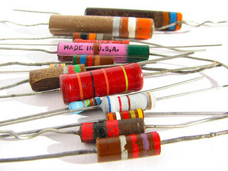 A bunch of resistors of different colors and sizes